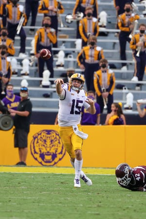 Sep 26, 2020; Baton Rouge, Louisiana, USA; LSU Tigers quarterback Myles Brennan (15) throws against the Mississippi State Bulldogs during the second half at Tiger Stadium. Mandatory Credit: Derick E. Hingle-USA TODAY Sports