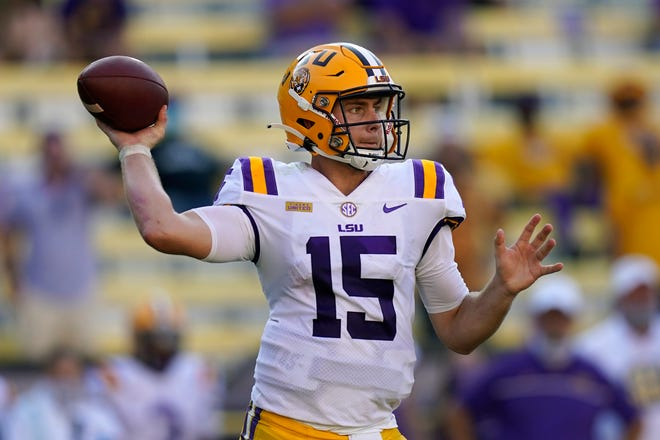 LSU quarterback Myles Brennan (15) passes in the second half an NCAA college football game against Mississippi State in Baton Rouge, La., Saturday, Sept. 26, 2020. Mississippi State won 44-34. (AP Photo/Gerald Herbert)