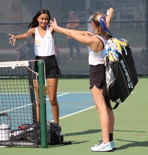 Wooster's Alexia Kakanuru and Emma Boreman celebrate after winning the OCC title in first doubles, helping lead the Generals to their first ever OCC tennis title as a team.