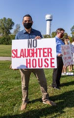 Marcelino Rivera III leads a demonstration along West Drexel Ave. with residents against the Strauss Brands' proposed slaughterhouse expansion in the city of Franklin on Friday, September 25, 2020.