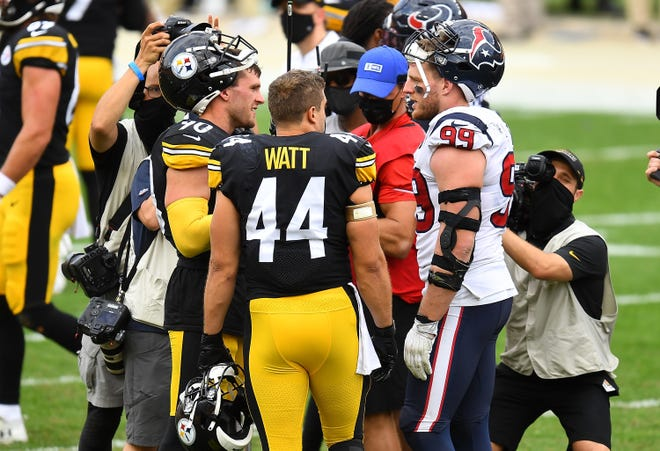T.J. Watt and Derek Watt of the Pittsburgh Steelers and J.J. Watt of the Houston Texans talk after Pittsburgh's 28-21 win on Sept. 27, 2020, at Heinz Field in Pittsburgh.