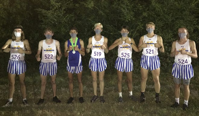 Mountain Home cross country runners Tyler Firment (from left), Jacob Lewis, Andrew Westphal, Whit Lawrence, Bryson Hodges, Ty Lawrence and Hendrix Hughes pose for a photo after placing second in the Gold Division of the 32nd annual Frank Horton Invitational on Saturday night at Memphis.