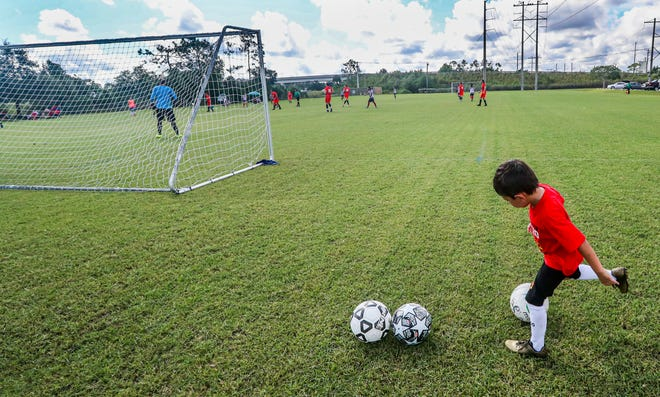 James Norelli, 5 of Naples, helped shag balls at the field for his father's team. Bonita Springs Soccer League kicked off its new season after the shutdown began. Normally there are lots of families and children running around, eating, chatting, watching, etc. Sunday leagues are a huge family event, particularly in the Bonita Springs Latino community. But now only 50 people can be on the field and that includes spectators. Games are held at Marni Fields, 11951 Southern Pines Dr, Bonita Springs.