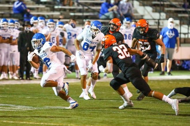 Shamrocks junior running back Mohamed Jaffer evades Brother Rice linebacker Oscar McWood