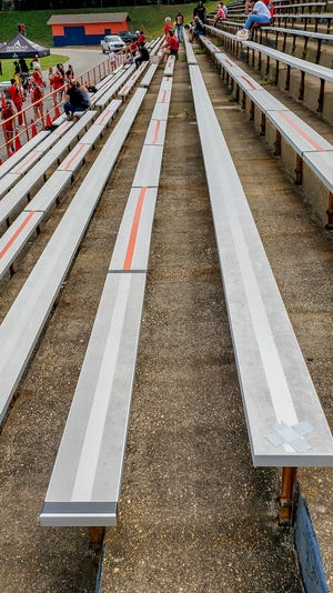 Escambia High School encouraged fans to wear masks and/or social distance from others not in their group during the football game against West Florida Tech on Saturday, Sept. 26, 2020, and marked off sections of bleachers to sit or not sit in.