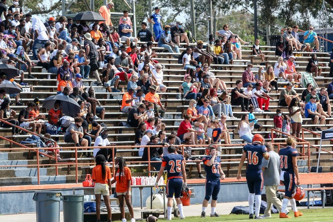 Escambia High School encouraged fans to wear masks and/or social distance from others not in their group during the football game against West Florida Tech on Saturday, Sept. 26, 2020.