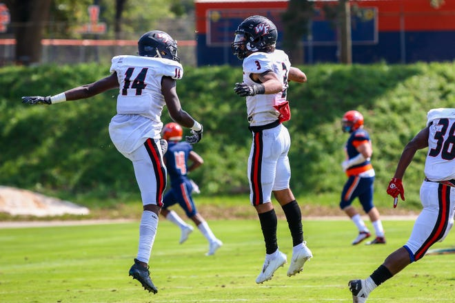 West Florida Tech's Collin Betties (14) and Isaac Walton Jr. (3) celebrate after Walton Jr. intercepted a Gators pass on Saturday, Sept. 26, 2020, during the season-opening game at Escambia High School. The Gators won 24-20.