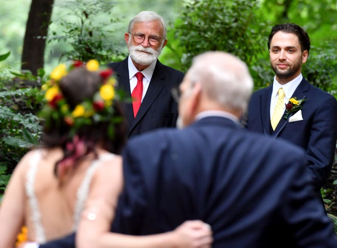 """Victoria and Nick Horan of York exchange vows before Robb Green, the """"Marrying Mayor,"""" at Stone Mill Inn, Sunday, September 27, 2020. The Horan ceremony was Green's 4000th wedding which he presided John A. Pavoncello photo"""