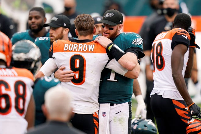 Philadelphia Eagles' Carson Wentz, right, meets with Cincinnati Bengals' Joe Burrow after an NFL football game, Sunday, Sept. 27, 2020, in Philadelphia. (AP Photo/Chris Szagola)