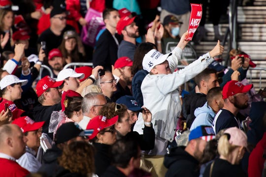 Supporters of President Donald Trump cheer as the president speaks about his support for law enforcement during a campaign rally at Avflight Harrisburg at the Harrisburg International Airport on Saturday, September 26, 2020, in Middletown, Pa.