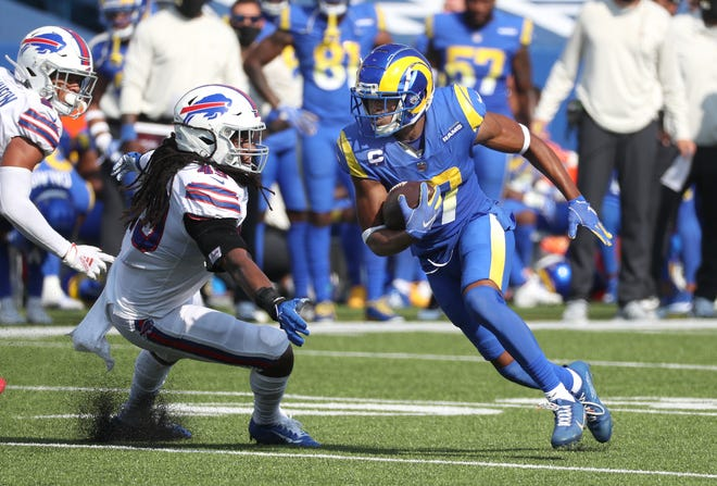 Rams receiver Robert Woods slips a tackle by Bills Tremaine Edmunds and scores on this 25-yard pass.