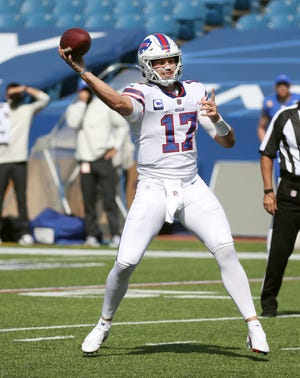 Bills quarterback Josh Allen looks to throw a short pass against the Rams.