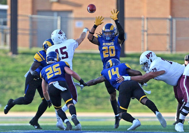 Donavyn Jackson, center, tries to block a pass attempt for Angelo State University during a game against West Texas A&M on Saturday, Sept. 26, 2020. Jackson is a former San Angelo Central High School standout.