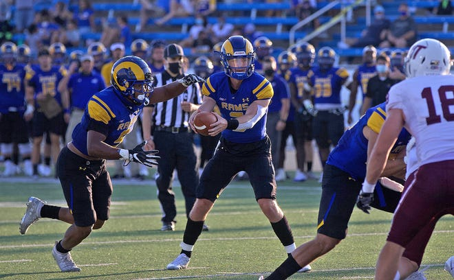 Zach Bronkhorst, center, hands off the ball for Angelo State University during a game against West Texas A&M on Saturday, Sept. 26, 2020.