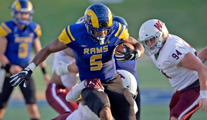 Carl Odom, center, rushes the ball for Angelo State University during a game against West Texas A&M on Saturday, Sept. 26, 2020.
