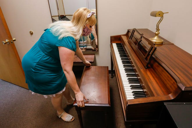 Heather Leverich, founder of the Conservatory of the Ozarks, prepares to move a piano that she sold on Saturday, Sept. 26, 2020. The Conservatory has had to close its doors due to the impact of COVID-19.