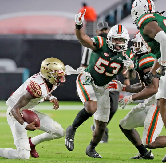 UM's linebacker Zach McCloud (53) celebrates a second quarter tackle on FSU quarterback James Blackman (1) as the University of Miami host Florida State University Seminoles at Hard Rock Stadium in Miami Gardens on Saturday, September 26, 2020.