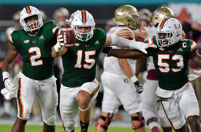 Miami lineman Jaelan Phillips celebrates intercepting a pass from Florida State during the first half of their game, Saturday, September 26, 2020.