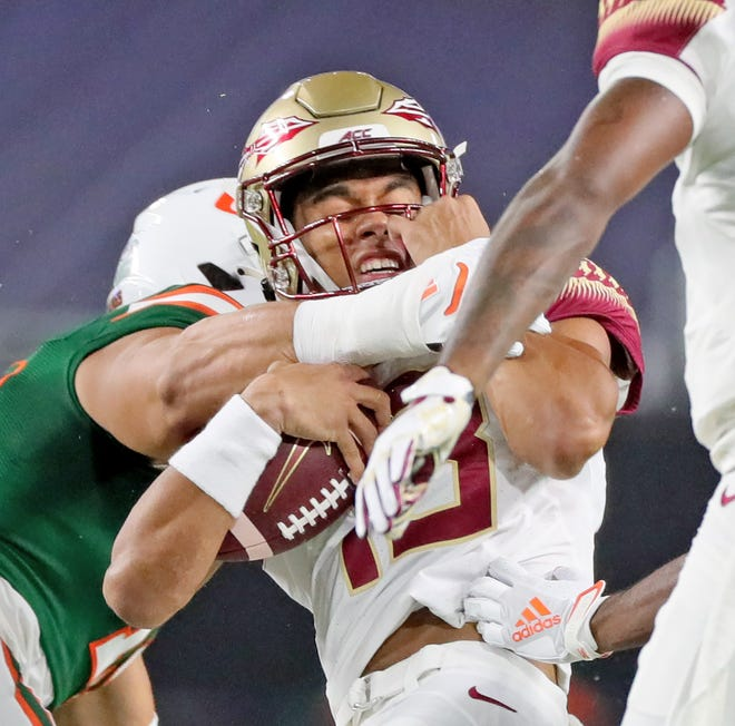 FSU's quarterback Jordan Travis' interception in the first half was one of many mistakes that led to Florida State's 52-10 blowout loss at Miami.