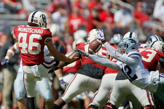Kansas State's AJ Parker blocks the punt of Oklahoma's Reeves Mundschau during the Wildcats' 38-35 win.