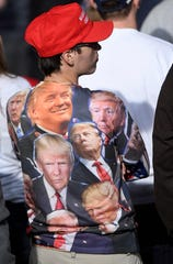 A supporter of President Donald Trump waits for the start of a Trump campaign rally at Harrisburg International Airport, Saturday, Sept. 26, 2020, in Middletown, Pa.