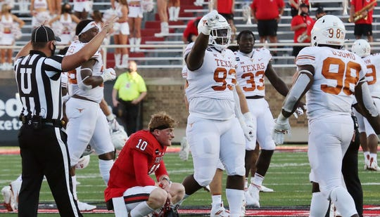 Texas players celebrate their overtime win against Texas Tech.
