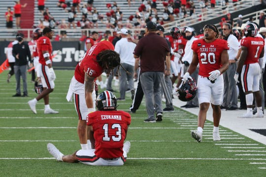 Texas Tech Red Raiders wide receiver Erik Ezukanma (13) and defensive back Travis Koontz (16) react after the game against the Texas Longhorns at Jones AT&T Stadium.