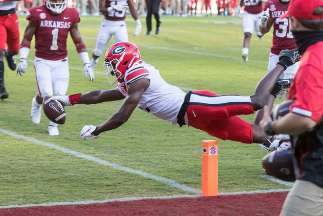 Georgia wide receiver George Pickens (1) dives into the end zone for a touchdown during the third quarter against Arkansas.