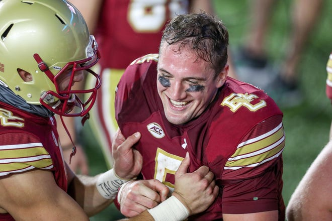Boston College quarterback Phil Jurkovec celebrates with teammates after defeating Texas State at Alumni Stadium. The former Pine-Richland High School QB faces Pitt in an ACC battle on Saturday.