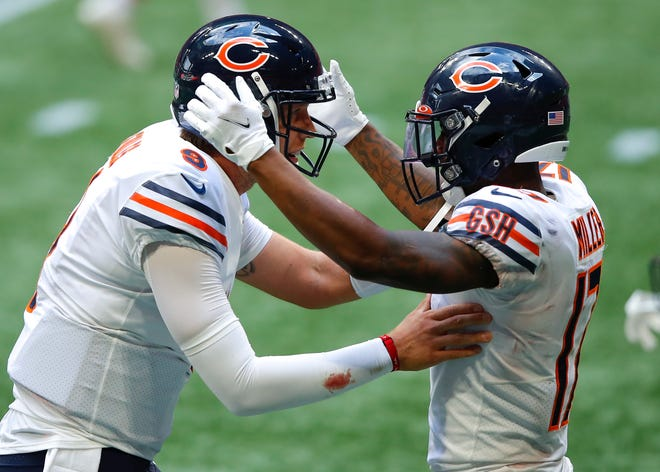 Anthony Miller #17 celebrates his touchdown with Nick Foles #9 of the Chicago Bears in the fourth quarter of an NFL game against the Atlanta Falcons at Mercedes-Benz Stadium on September 27, 2020 in Atlanta, Georgia.