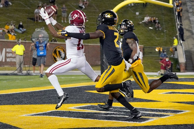 Alabama wide receiver Jaylen Waddle (17) catches a touchdown against Missouri during the first half at Faurot Field at Memorial Stadium.