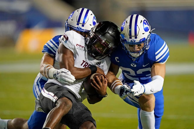 Troy wide receiver Kaylon Geiger is tackled during the first half against BYU.