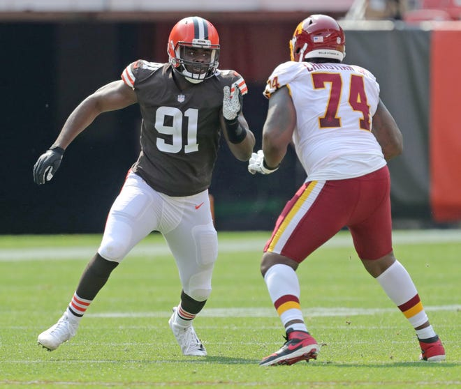 Cleveland Browns' Joe Jackson goes up against Washington offensive tackle Geron Christian Sr. on Sunday, Sept. 27, 2020 in Cleveland, Ohio at FirstEnergy Stadium. The Browns won the game 34-20. [Phil Masturzo/ Beacon Journal]