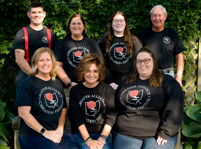 The 2020-21 Greater Alliance Area Carnation Festival Board of Directors includes, seated from left, Staci Gurney, president; Lori Gasparek, president elect; Abbey Blake, vice president; and standing from left, Josh Cioci, vice president; Kim Springer, vice president; Bethany Baranyk, vice president; and Tom Hines, newly elected board member.