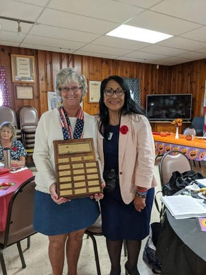 Unit 88 president Mary Ann Dull (left) received the Veterans Affairs and Rehabilitation plaque from District Chairman Dayna Beyer.
