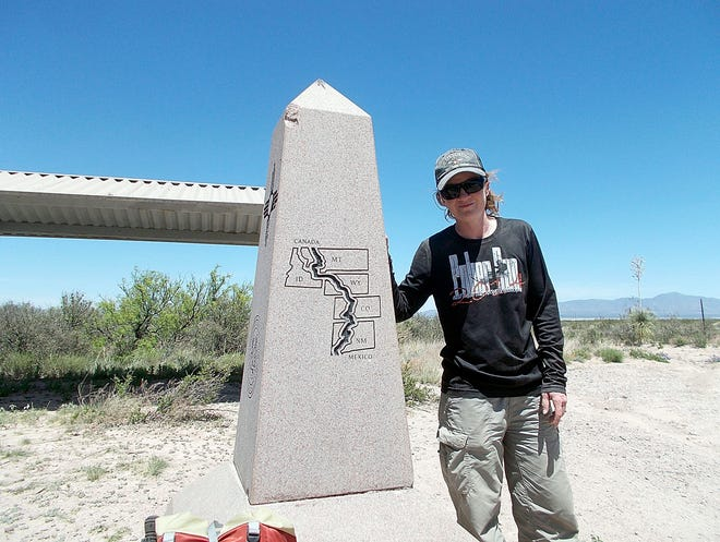 Mary Ann Lang poses at the Mexican border, the start of the Continental Divide Trail.