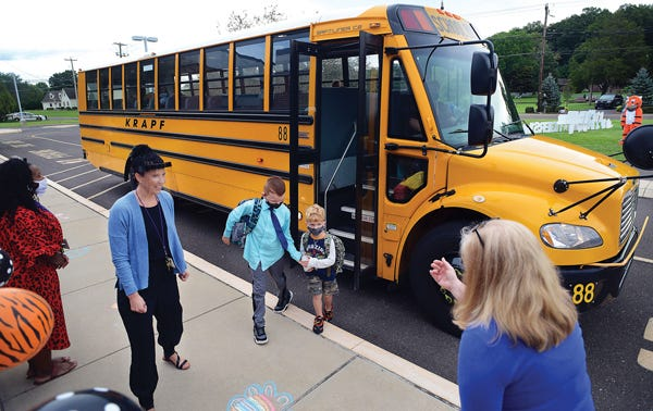 Staff at Tinicum Elementary School in the Palisades School District welcome students back for full-time in-person instruction Aug. 31. The district has so far had no COVID-19 cases among students.
