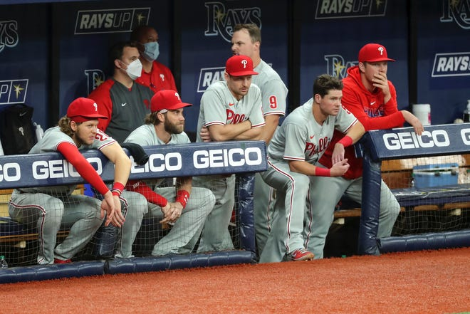 Phillies players watch late in Sunday's season-ending loss to the Rays in Tampa.