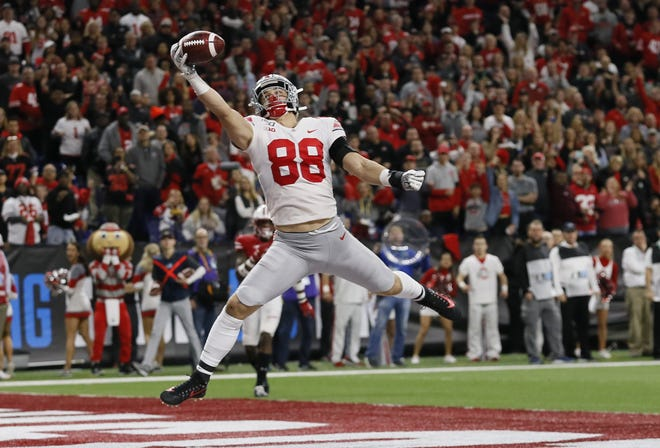 Ohio State tight end Jeremy Ruckert catches a 16-yard touchdown pass during the Big Ten championship game against Wisconsin on Dec. 7. [Adam Cairns/Dispatch]
