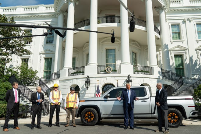 President Donald Trump answers reporters' questions Monday while standing in front of a prototype Lordstown Motors electric truck.