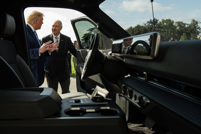 Lordstown Motors CEO Steve Burns shows President Donald Trump the cab of the company's prototype electric truck outside the White House on Monday.