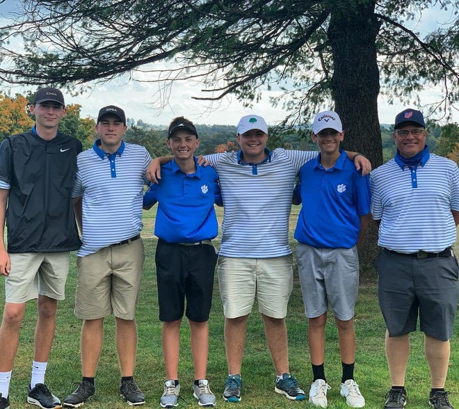 A happy Cambridge High golf team is shown following Monday's Division II Sectional tournament at Cadiz Country Club. The Bobcats finished in third place to advance on to district competition.
