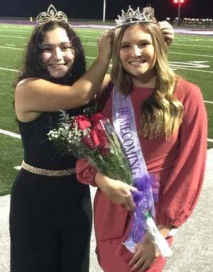 The 2019 Triway Homecoming queen, Ally Yacapraro, passes the crown on to new queen, Olivia Mathis. The queen was named on Friday night at halftime of the Triway and Tuslaw football game.