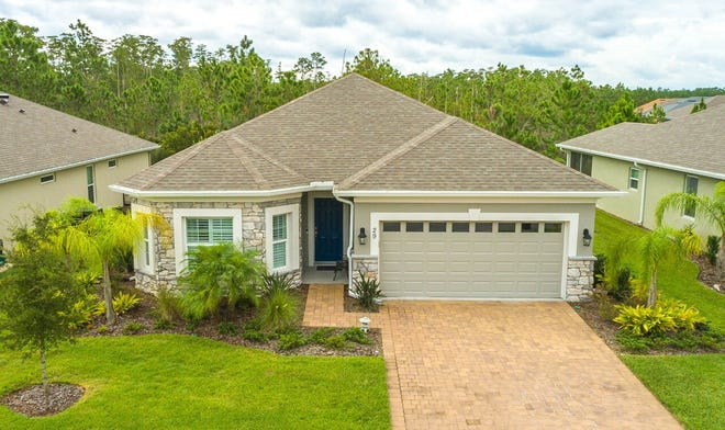 A paver driveway leads to this meticulously maintained, turn-key home in Hunter's Ridge's 55-and-over section of Huntington Village, which has more than $80,000 in upgrades.