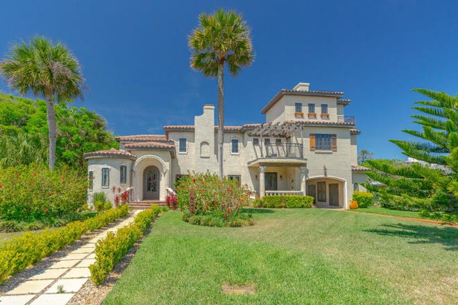 Located in Daytona's premier beachside neighborhood of Ocean Dunes, this 1927 home is situated on large lot, with lush tropical landscaping, and is only steps from the beach.