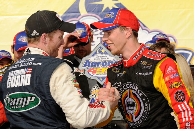 Dale Earnhardt Jr., left, congratulates 25-year-old Brad Keselowski after the first of five career wins at Talladega in 2009. The victory sparked Keselowski's NASCAR Cup Series career.