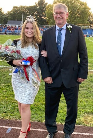 Sarah Boots was crowned the 2020 Lincoln High School homecoming queen prior to the Wolverines game against the Beaver Falls High School Tigers on Friday. Daniel Boots escorted his daughter.