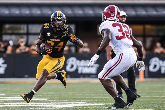 Missouri's Larry Rountree (34) carries the ball during Saturday's season opener against Alabama  at Faurot Field. Rountree gained 67 yards and appears primed for a big senior season.