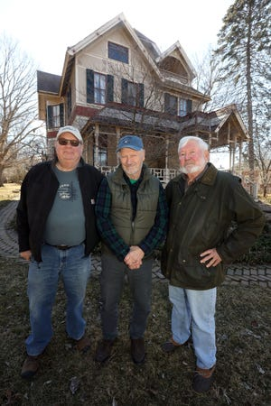 From left paul Ziglar, Steve Brower and Dave Riley, members of the Aldo Leopold Landscape Alliance, in front of Aldo Leopold's boyhood home March 3 in Burlington. The alliance, a non-profit organization owns and administers the childhood homes of conservationist Aldo Leopold.