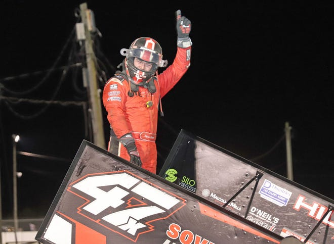 Dylan Westbrook celebrates his 360 Fall Haul Sprint Invaders win Saturday at 34 Raceway.